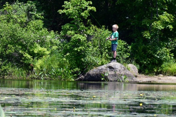 Boy fishing at McDowell Lake in Peterborough, NH