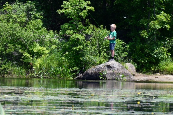 Boy fishing at McDowell Lake in Peterborough, NH